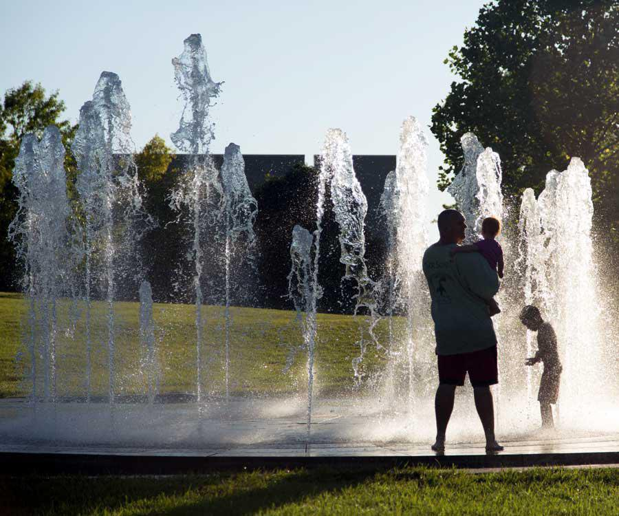 Nothing says summer like cooling off in the splash fountains at Jordan Valley Park.