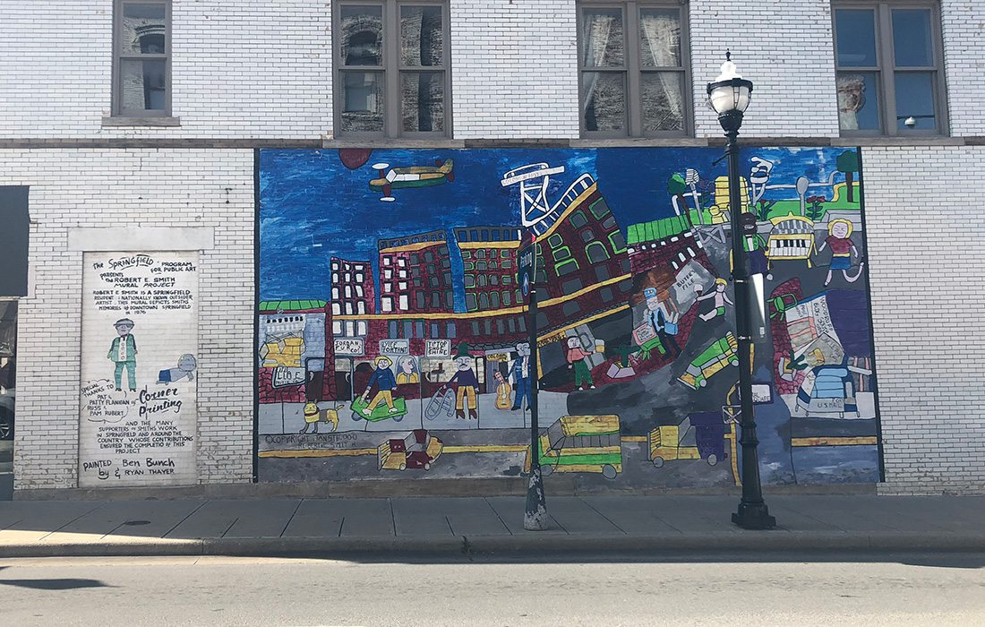 colorful mural in downtown springfield of the town in 1975