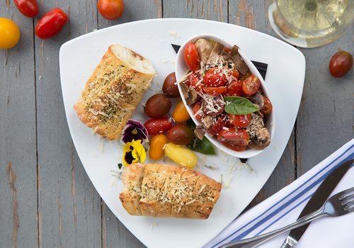 In Gilardi's Ristorante's bruschetta, tomatoes mingle with honey balsamic marinated mushrooms.