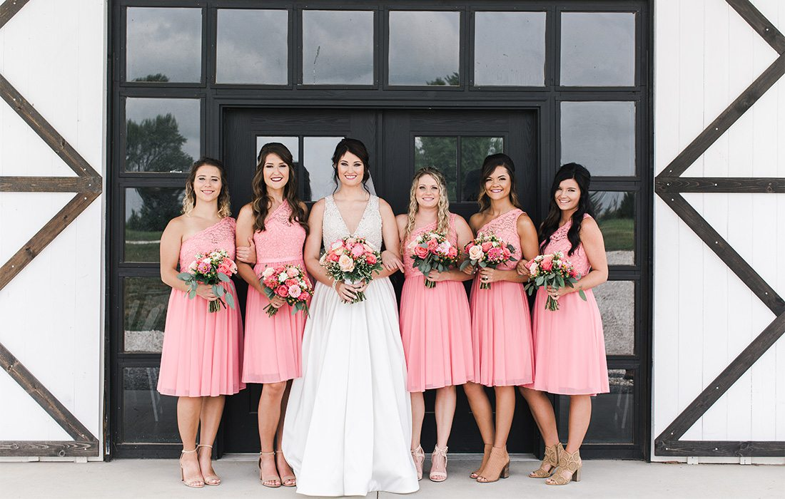bride and bridesmaids with short pink dresses