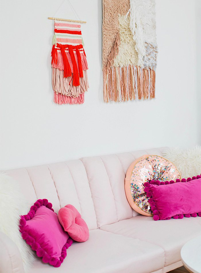 couch, pillows and wall decor