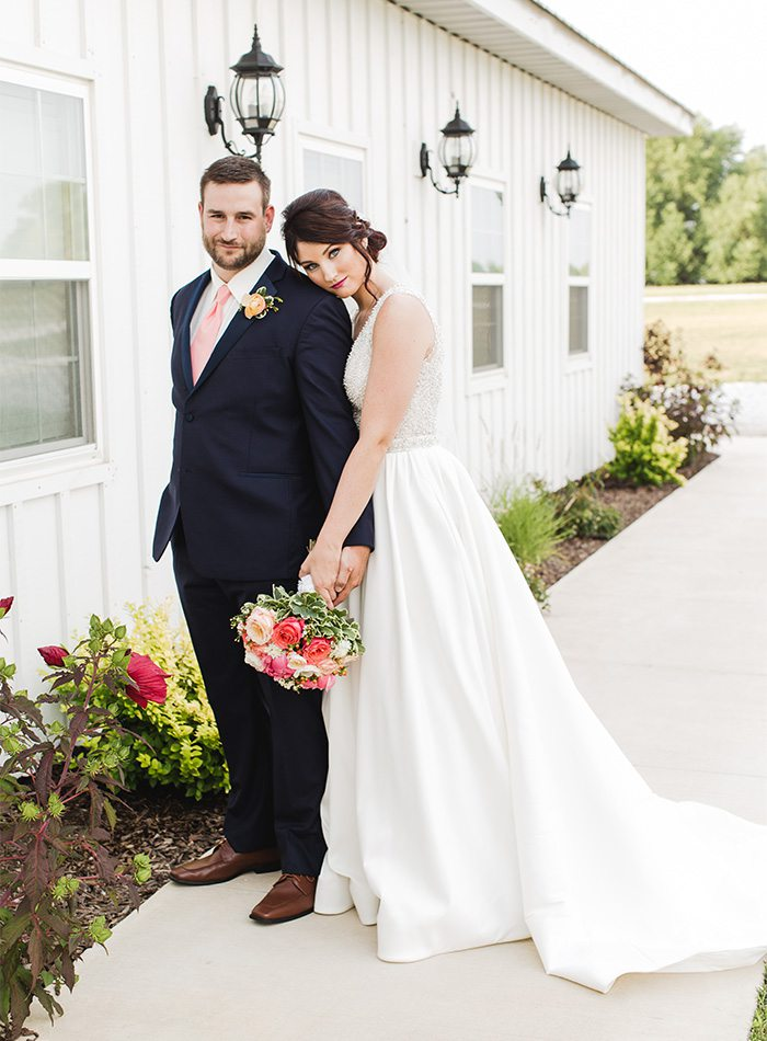 bride and groom with a pink bouquet