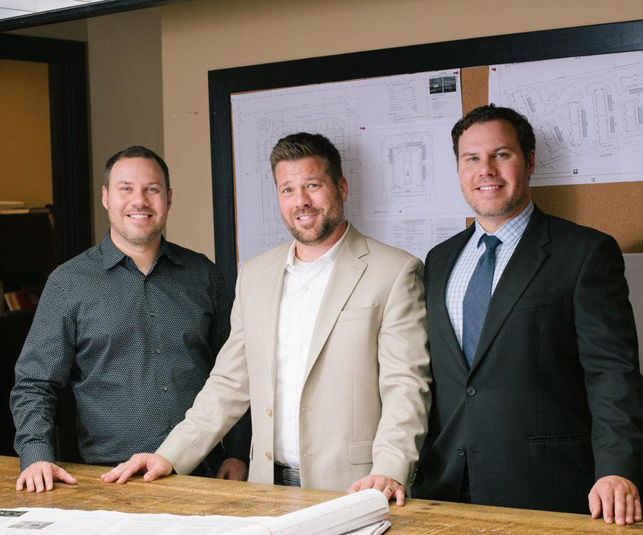 Dave, Sam M. and Dan Coryell, left to right, at the TLC Properties office.