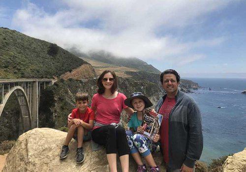 family poses in California