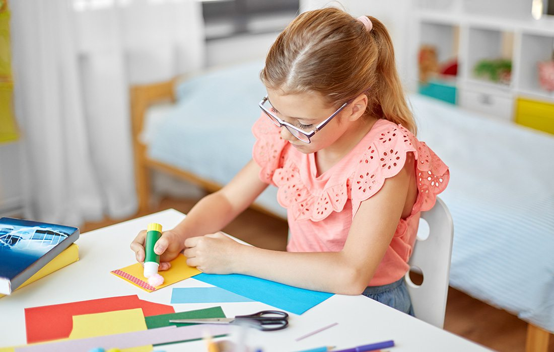 Young girl creating artwork at home