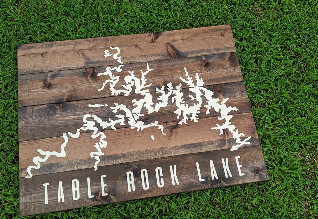 Custom made wooden sign with white painting of table rock lake