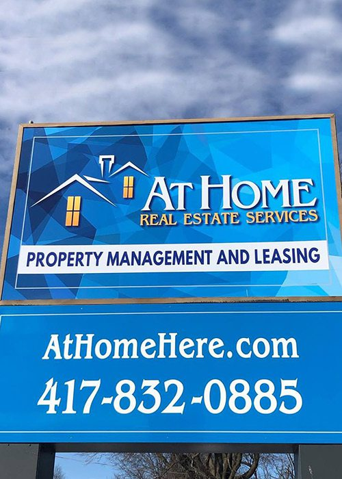 At Home Real Estate Services sign in Springfield, MO