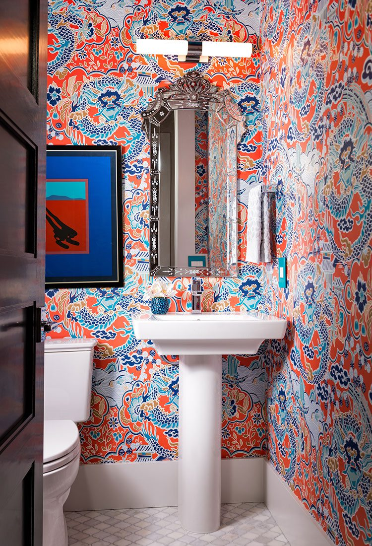 orange and blue wallpaper in a redesigned bathroom