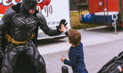 Springfield MO Batman high fiving a kid