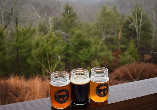 Beer Creek drinks overlooking forest