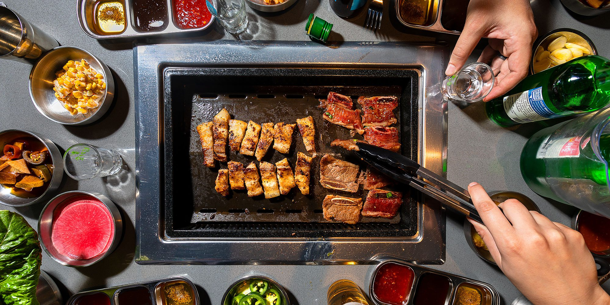 Overhead shot of grill built into a table at Bawi Korean BBQ in Springfield MO