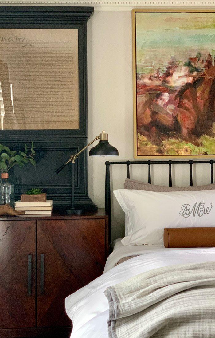 Bediset cabinet with black metal bedframe and black-and-gold bedside lamp.