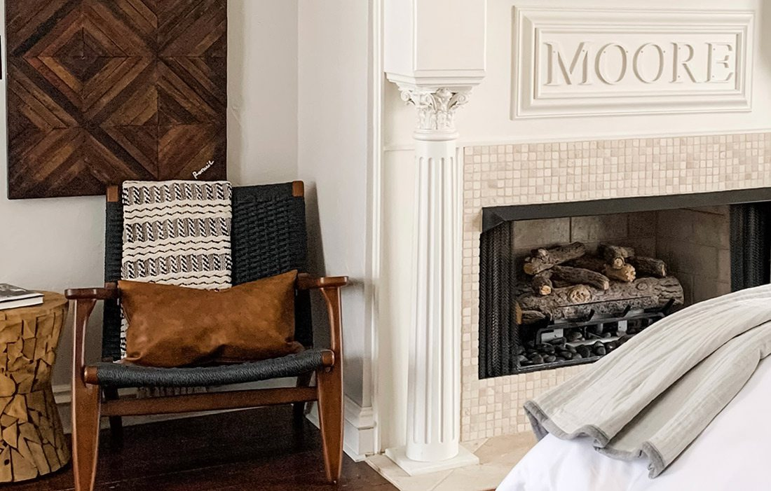 Fireplace and chair in bedroom that won Best Bedroom award