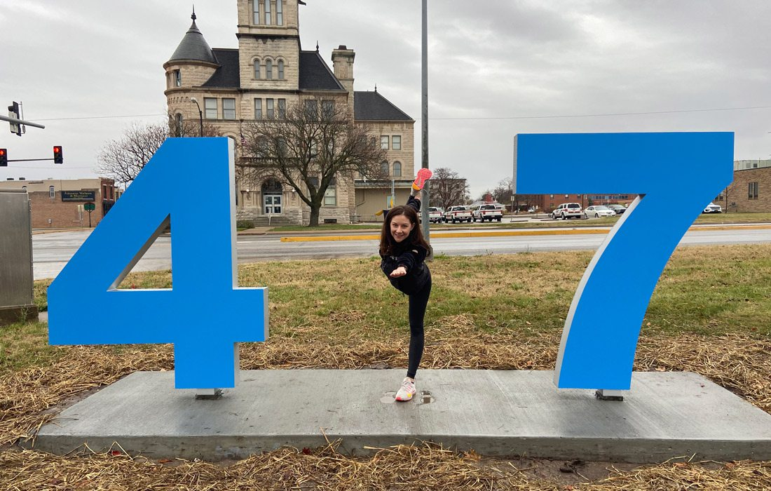 Logan Aguirre at the #417betheone sign.