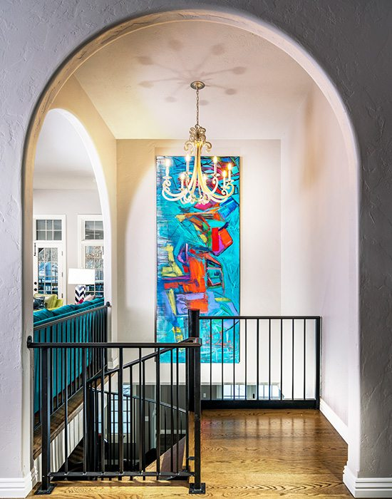 Painting by Betty Parnell hanging in a home designed by Obelisk Home