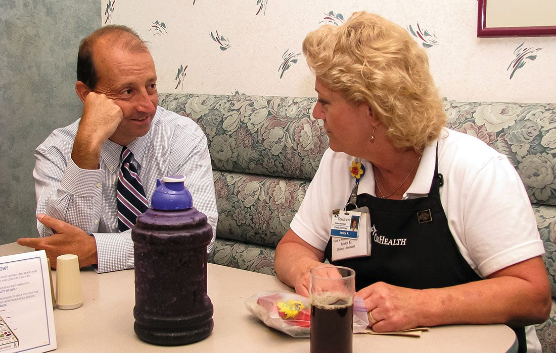 CoxHealth CEO Steve Edwards talking with hospital staff