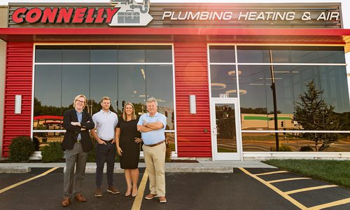 Connelly Plumbing's owners outside business.