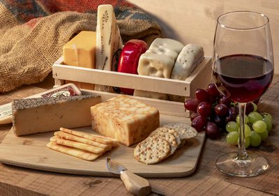 Charcuterie board and a glass of wine.
