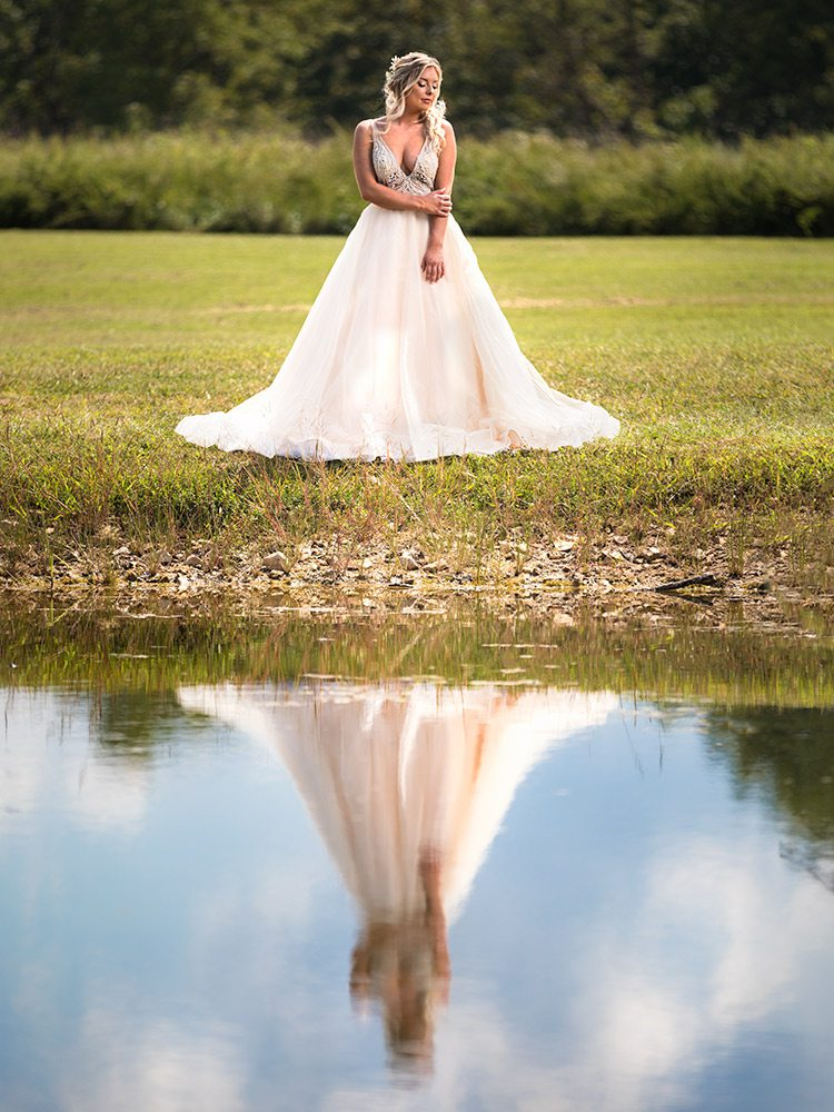 Champagne empire waist with sheer tulle wedding dress at Touch of Class Springfield MO
