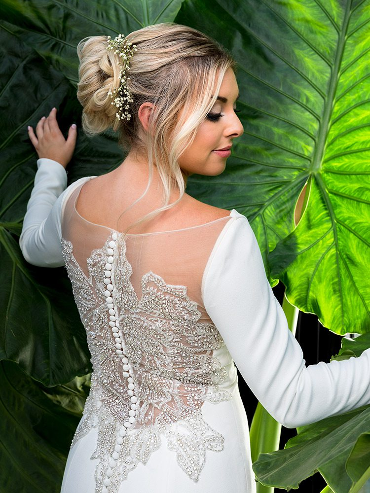 Ivory detailed back beading long sleeved wedding dress at Normans Bridal Springfield MO
