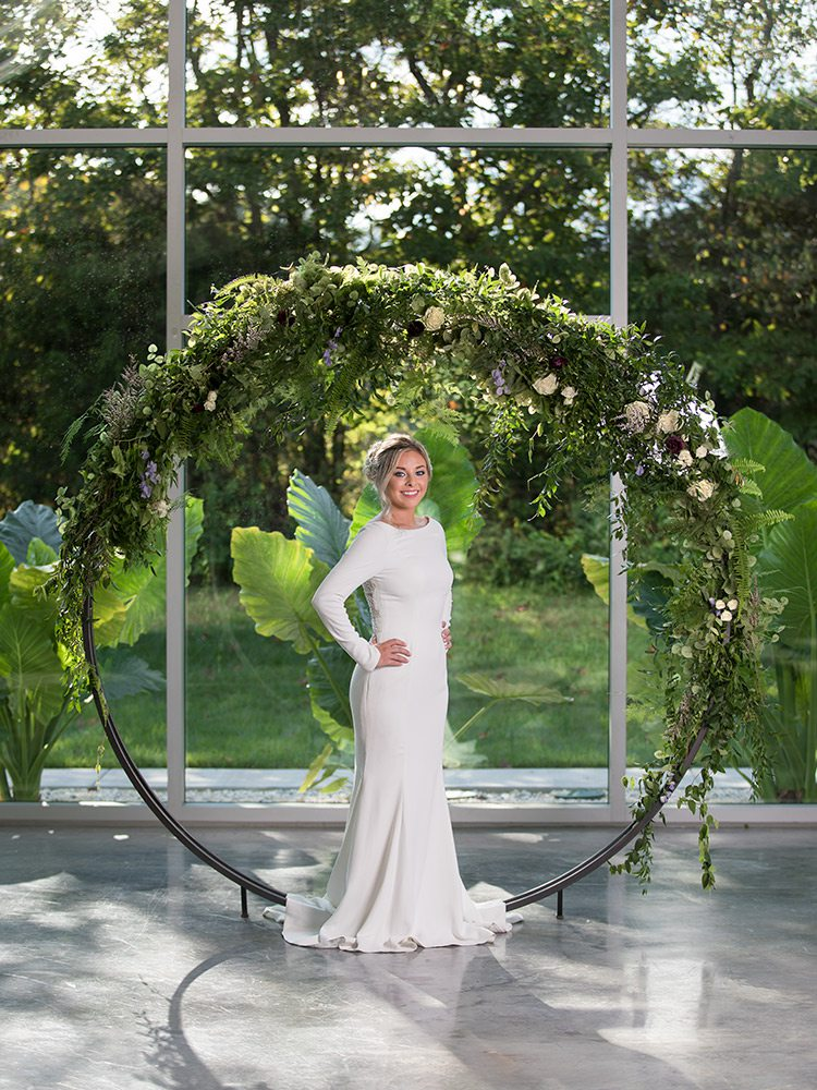 Justin Alexander long sleeved wedding dress at Normans Bridal Springfield MO