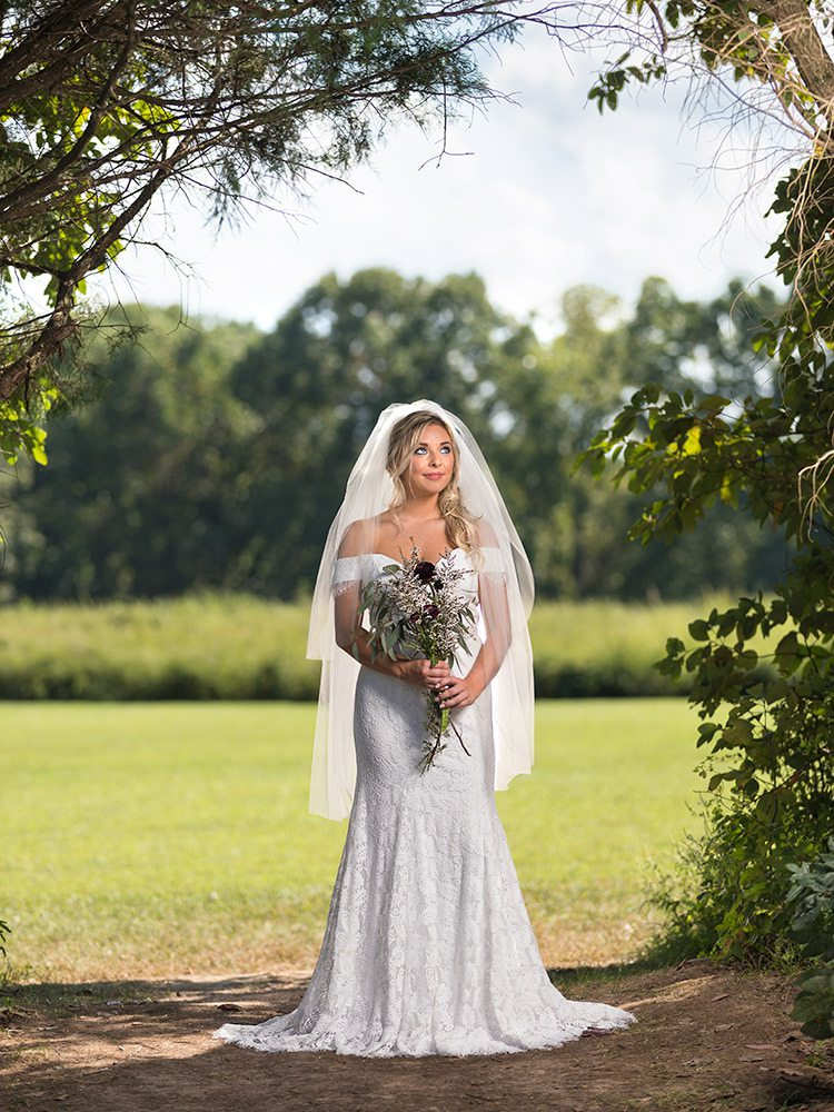 Off the shoulder white lace wedding gown at The Dress Springfield MO