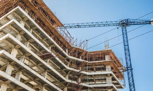 Building construction site with a crane