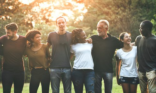 Diverse group of people arm in arm