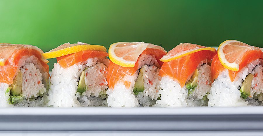 California sushi roll topped with lemon