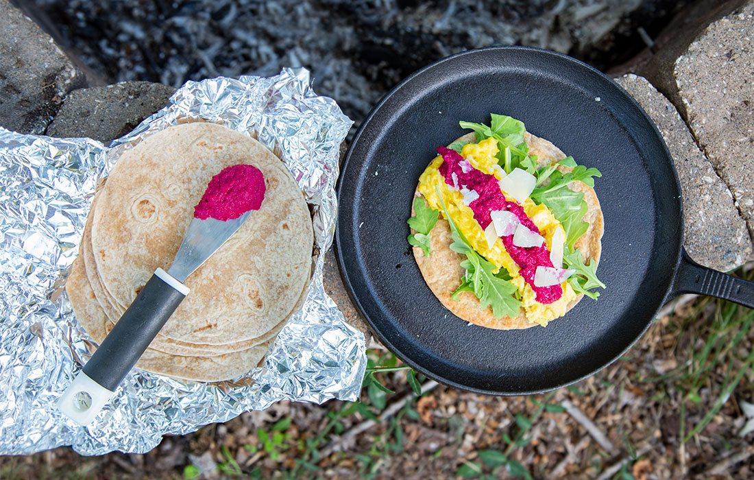 breakfast burritos over a campfire