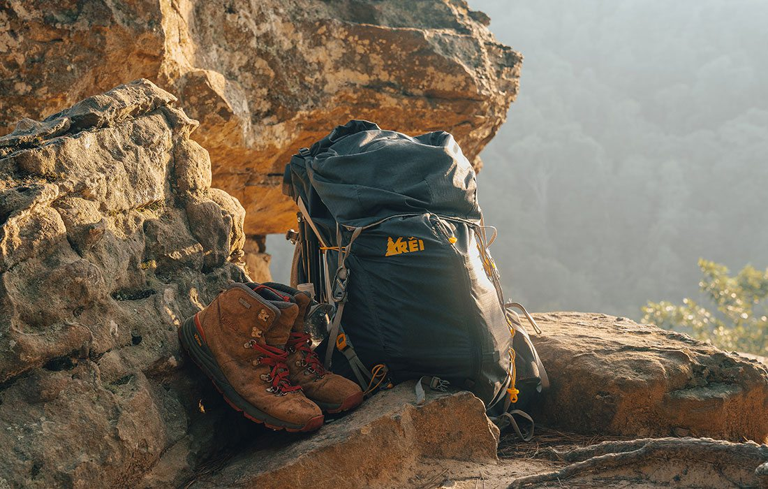 backpack and boots on a hiking trail