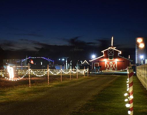 christmas lights and a red barn