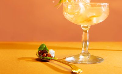 Caprese Martini on orange background