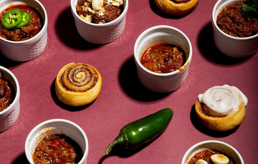 Bowls of chili and cinnamon rolls
