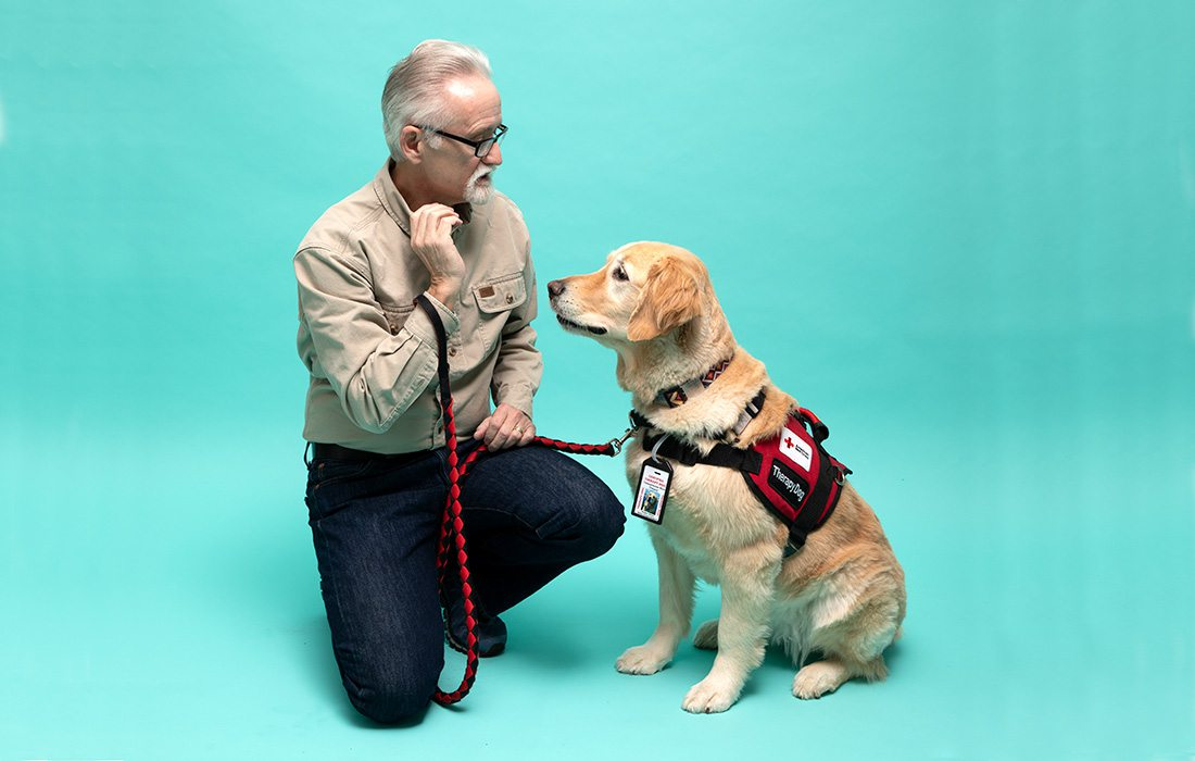 Walter Roberts and his therapy golden retriever Choppy