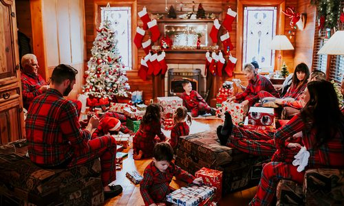 The Clouse family gathers in the living room to open Christmas presents