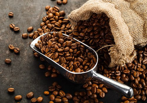 Coffee beans and a metal scoop