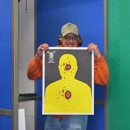 man holding a shooting target