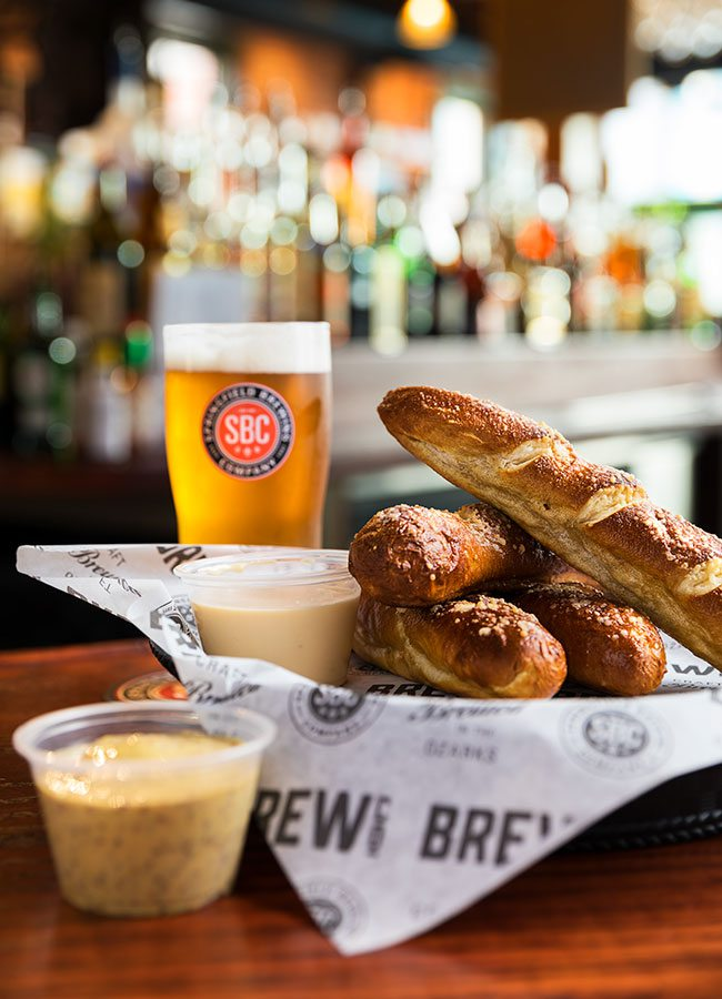 Soft pretzel sticks with beer cheese and a draft beer at Springfield Brew Co.