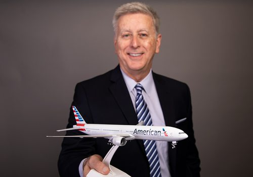 David Agee holding model American Airlines airplane