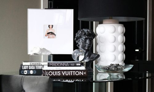 Glass furniture and black and white accessories