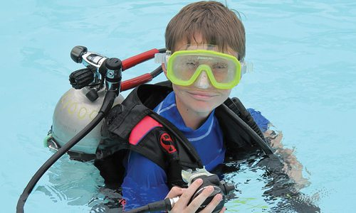 Young boy learning to scuba dive at Diventures in Springfield MO