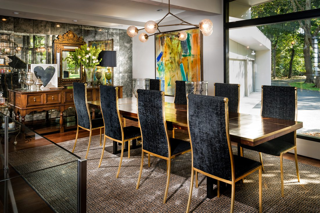 Mid-century dining room with vintage elements, brass accents.
