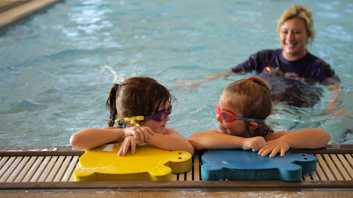 Young kids learning to swim at Diventures in Springfield MO