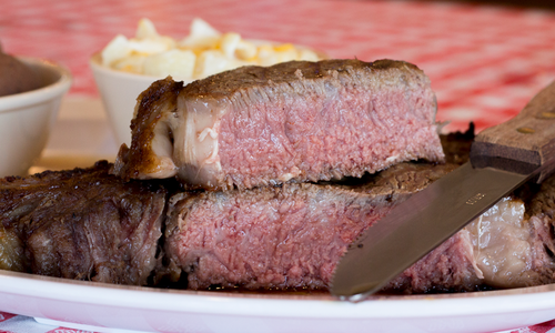 Dine on Giant Steaks at Doe's Eat Place