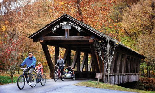 Family on bikes at Dogwood Canyon in Lampe MO