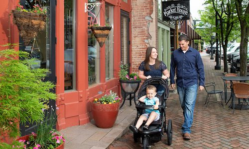 Young family walks in Downtown Ozark, MO