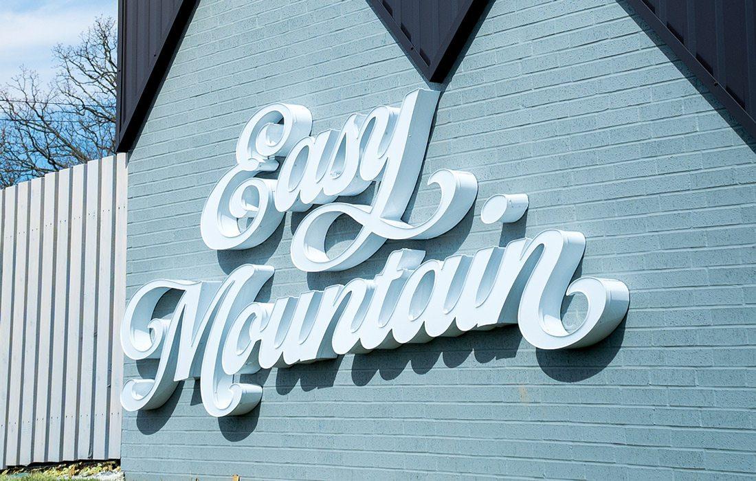 Easy Mountain logo exterior
