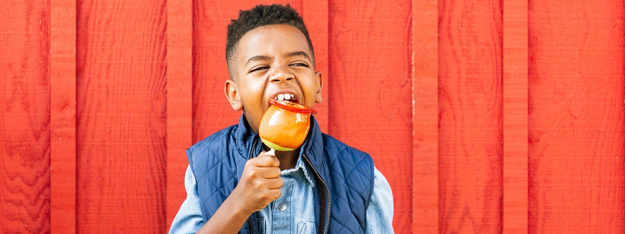 Eli Roberts eating candy apple