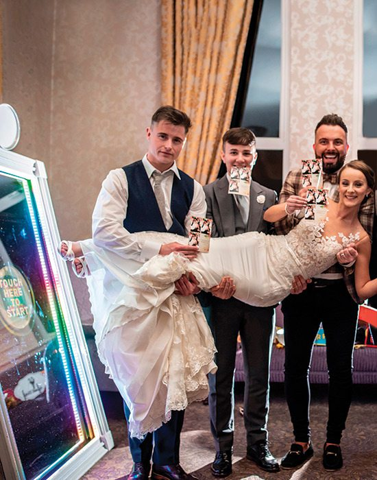 Bride and wedding party in an Elite Photobooth